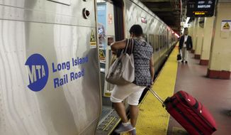"""FILE - In this July 15, 2014, file photo, passengers board a Long Island Rail Road train, in New York's Penn Station. Some frustrated Long Island Rail Road riders are suing the Metropolitan Transportation Authority, the LIRR's parent organization, claiming breach of contract, negligence and """"intentional infliction of emotional distress,"""" over chronic shutdowns, delays and packed trains. (AP Photo/Richard Drew, File)"""