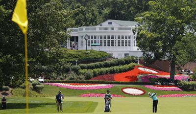 Tony Finau, right, takes his second shot on the first hole during the final round of the Greenbrier Classic PGA Tour golf tournament Sunday, July 9, 2017, in White Sulphur Springs, W.Va. (AP Photo/Steve Helber)