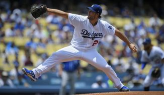 Los Angeles Dodgers starting pitcher Clayton Kershaw throws to the plate during the first inning of a baseball game against the Kansas City Royals, Sunday, July 9, 2017, in Los Angeles. (AP Photo/Mark J. Terrill)