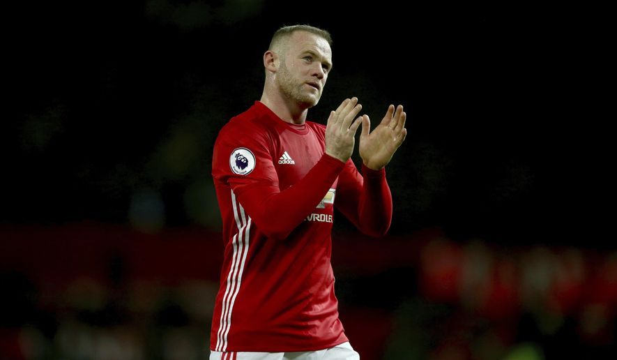 FILE - In this Sunday, Jan. 15, 2017 file photo, Manchester United's Wayne Rooney leaves the field after the English Premier League soccer match between Manchester United and Liverpool at Old Trafford stadium in Manchester, England. Wayne Rooney has left Manchester United to rejoin Everton after 13 years at Old Trafford, it was announced on Sunday, July 9, 2017. Everton says Rooney signed a two-year contract. (AP Photo/Dave Thompson, file)