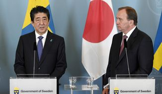 Swedish prime minister Stefan Lofven, right, and Japanese Prime Minister  Shinzo Abe attend a press conference after their meeting in Stockholm, Sunday, July 9, 2017. Shinzo Abe is in Stockholm for a two day visit. (Maja Suslin/TT via AP)