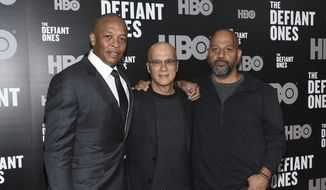 "FILE - In this June 27, 2017, file photo, music mogul Jimmy Iovine, center, poses with rapper Dr. Dre, left, and producer Allen Hughes at the premiere of HBO's ""The Defiant Ones"" at the Time Warner Center in New York. The four-part documentary series tracks the lives of Iovine and Dre, and their unlikely partnership turning out hit records and creating Beats headphones, which they sold to Apple in 2014. (Photo by Evan Agostini/Invision/AP, File)"