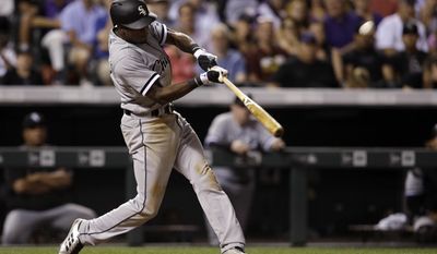 Chicago White Sox'sTim Anderson hits a solo home run off Colorado Rockies pitcher Greg Holland during the ninth inning of a baseball game Saturday, July 8, 2017, in Denver.(AP Photo/Joe Mahoney)