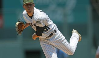 Colorado Rockies starting pitcher Kyle Freeland delivers to Chicago White Sox's Adam Engel in the first inning of a baseball game Sunday, July 9, 2017, in Denver. (AP Photo/David Zalubowski)