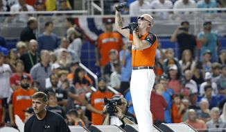 Rapper Pitbull performs during the opening ceremony of the the MLB baseball All-Star Home Run Derby, Monday, July 10, 2017, in Miami. (AP Photo/Wilfredo Lee)