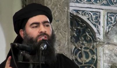 This file image made from video posted on a militant website July 5, 2014, purports to show the leader of the Islamic State group, Abu Bakr al-Baghdadi, delivering a sermon at a mosque in Iraq during his first public appearance. (AP Photo/Militant video, File)