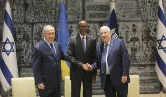 Rwanda's President, Paul Kagame, center, Israel's President Reuven Rivlin right, and Israeli Prime Minister Benjamin Netanyahu pose for a photo at the President's residence in Jerusalem, Monday, July 10, 2017. (AP Photo/Sebastian Scheiner)