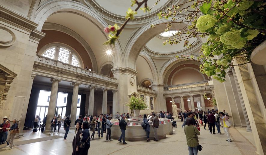 Visitors traverse the Great Hall as they enter the Metropolitan Museum of Art, in New York, Wednesday, May 10, 2017. (AP Photo/Richard Drew)