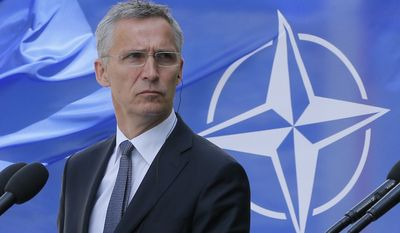 """NATO Secretary General Jens Stoltenberg attends a joint press conference with Ukrainian President, Petro Poroshenko in Kiev, Ukraine, Monday, July 10, 2017.  Speaking Monday with NATO Secretary General Jens Stoltenberg in Kiev, Ukraine President Poroshenko said Ukraine would not be applying for a NATO membership """"immediately"""" but would instead """"build a genuine program of reforms"""" to meet NATO requirements for membership in the future. (AP Photo/Efrem Lukatsky)"""