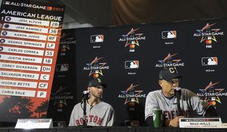 American League All-Star Game starting pitcher Chris Sale, left, looks on as AL manager Brad Mills speaks during a press conference for the All-Star game in Miami, Monday, July 10, 2017. (AP Photo/Ron Blum