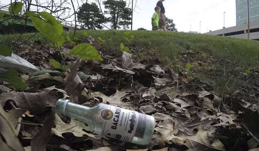 "In this Friday, July 7, 2017 photo, a discarded miniature bottle of Barcardi rum lies on the ground near Preble Street in Portland, Maine. A Maine-based bottler, Sazerac Co., is blasting Maine Gov. Paul LePage's argument that the increase sales of miniature bottles, also called ""nips,"" are behind an increase in drunken driving. LePage wants to end sales of the liquor mini-bottles in Maine. The future of the popular, shot-sized ""nips"" in Maine is in the hands of a state liquor bureau set to vote Tuesday, July 11. (AP Photo/Robert F. Bukaty)"