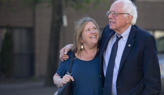 FILE - In this April 19, 2016, file photo, Democratic presidential candidate Sen. Bernie Sanders, I-Vt., and his wife Jane take a walk in State College, Pa. A Republican lawyer pushing the allegations that Sen. Bernie Sanders' wife committed bank fraud to win a loan while president of a now-defunct Vermont college has a long history of filing complaints against left-of-center politicians in the state. (AP Photo/Mary Altaffer, File)