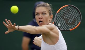 Romania's Simona Halep returns to Victoria Azarenka of Belarus during their Women's Singles Match on day seven at the Wimbledon Tennis Championships in London Monday, July 10, 2017. (AP Photo/Alastair Grant) **FILE**