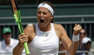 Latvia's Jelena Ostapenko celebrates after beating Ukraine's Elina Svitolina in their Women's Singles Match on day seven at the Wimbledon Tennis Championships in London Monday, July 10, 2017. (AP Photo/Alastair Grant)