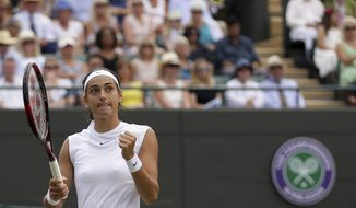 Caroline Garcia of France celebrates after winning a point against Britain's Johanna Konta during their Women's Singles Match on day seven at the Wimbledon Tennis Championships in London Monday, July 10, 2017. (AP Photo/Tim Ireland)