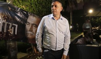 Israeli Avi Gabbay stands in Tel Aviv, Israel, Monday, July 10, 2017. Israel's Labor Party has elected political newcomer Avi Gabbay as its new leader, placing him at the head of the opposition to Prime Minister Benjamin Netanyahu. (AP Photo/Tsafrir Abayov)