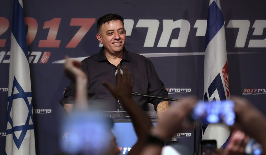 Avi Gabbay speaks to supporters following his victory in Tel Aviv, Israel, Monday, July 10, 2017. Israel's Labor Party has elected political newcomer Avi Gabbay as its new leader, placing him at the head of the opposition to Prime Minister Benjamin Netanyahu. (AP Photo/Tsafrir Abayov)