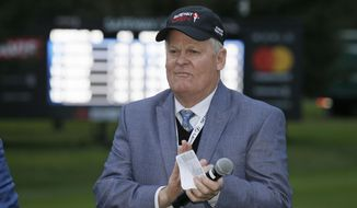 FILE - In this Oct. 16, 2016, file photo, Johnny Miller stands on the 18th green of the Silverado Resort North Course during the trophy presentation of the Safeway Open PGA golf tournament, in Napa, Calif. Television viewers haven't heard the last of Johnny Miller just yet.Miller says he thought this might be his final year in the broadcast booth for NBC Sports so he could spend more time with his 23 grandchildren. But in a telephone interview Monday, July 10, 2017, he said he will stick around for at least another year. This is his 28th year working for NBC.(AP Photo/Eric Risberg, File)