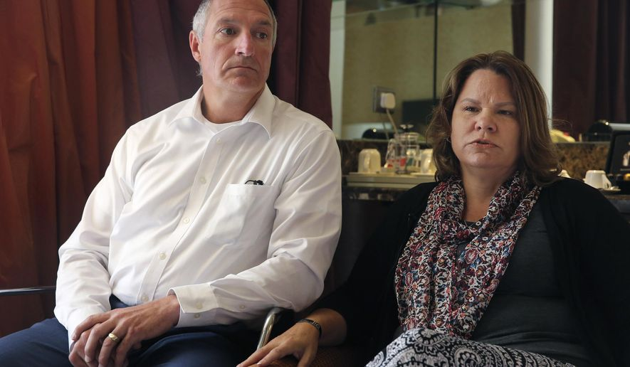 Cynthia, right, 53, and Charles Lewellen, 53, speak during an interview in Amman, Jordan on Monday, July 10, 2017 after attending a hearing in the trial into the killing of their son Staff Sgt. Matthew Lewellen on Nov. 4, 2016 at a Jordanian air base along with two other American Green Berets. The bereaved parents are disappointed in the military judge's refusal to make public a surveillance video from the incident as well as testimony from an American special forces operator at the scene. (AP Photo/Sam McNeil)
