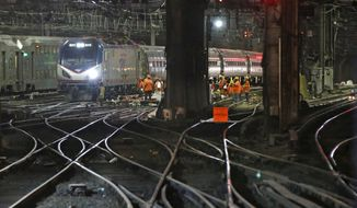 Amtrak workers continue ongoing infrastructure renewal work on the tracks beneath Penn Station, Sunday, July 9, 2017, in New York. A massive two-month repair project will launch Monday at the country's busiest train station. The summer's accelerated repair work, prompted by two derailments this spring, will close some of the station's 21 tracks and require a roughly 20 percent reduction in the number of commuter trains coming in from New Jersey and Long Island. (AP Photo/Kathy Willens)