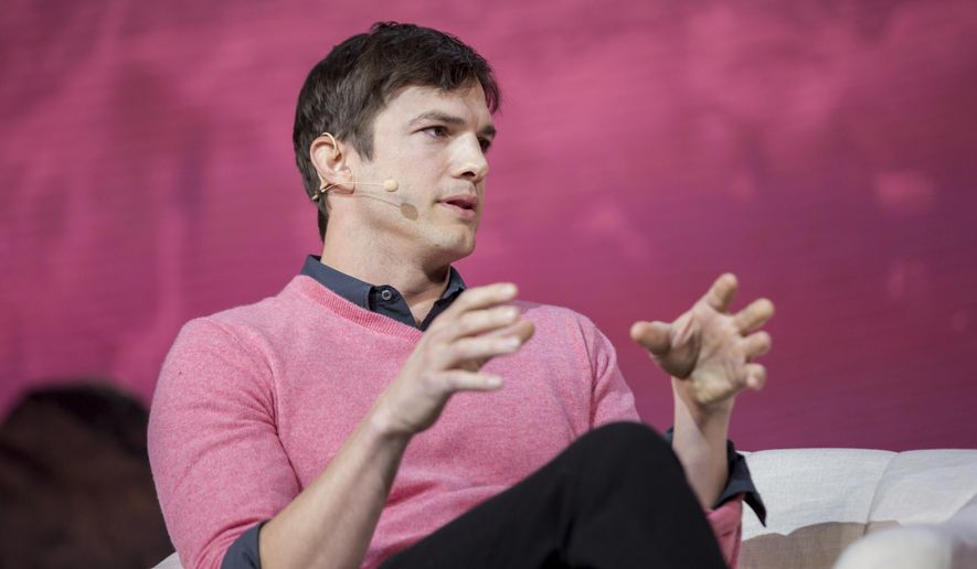 FILE - In this Nov. 19, 2016, file photo, Ashton Kutcher speaks at a panel during the Airbnb Open Spotlight at The Orpheum Theatre in Los Angeles. Kutcher explained tweeted a quick explanation on July 9, 2017, after a tabloid questioned why he was seen out and about with a mystery woman recently; it was his cousin. (Photo by Willy Sanjuan/Invision/AP, File)