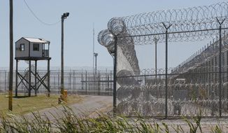 A tower is pictured outside of the razor wire at the Great Plains Correctional Facility in Hinton, Okla, Monday, July 10, 2017. (AP Photo/Sue Ogrocki) **FILE**