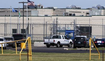 A GEO corrections vehicle drives past the front gate of the Great Plains Correctional Facility in Hinton, Okla, Monday, July 10, 2017. The GEO Group, Inc. the Florida-based operator of the private prison, estimated that about 400 inmates caused a disturbance late Sunday, July 9, 2017, taking two guards hostage and refusing to return to their cells before they were finally corralled by law enforcement officers. (AP Photo/Sue Ogrocki)