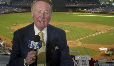 FILE - In this July 3, 2002, file photo, Los Angeles Dodgers television play-by-play announcer Vin Scully rehearses before a game between the Dodgers and the Arizona Diamondbacks, in Phoenix. Vin Scully will receive the Icon Award at The ESPYS, with actor Bryan Cranston presenting the honor given to those whose careers have left a lasting impression on the sports world. Scully retired last fall after 67 years calling Los Angeles Dodgers games.  (AP Photo/Paul Connors, File)
