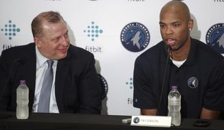 Minnesota Timberwolves head coach Tom Thibodeau, left, sits with new team member Taj Gibson in Minneapolis, Monday, July 10, 2017. (Richard Tsong-Taatarii/Star Tribune via AP)