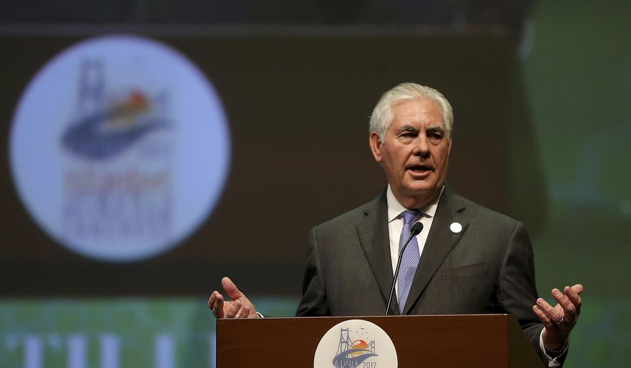 """U.S. Secretary of State Rex Tillerson gestures as he delivers a speech at the World Petroleum Congress, hosted by Istanbul, Turkey, Sunday, July 9, 2017. Council President Jozsef Toth, who described Tillerson, who is from Texas, as """"a man born with oil in his veins"""" before presenting him with the Dewhurst Award, named after the founder of the congress. The former ExxonMobile chief expressed his gratitude and said he misses """"colleagues, partners and competitors"""" in the oil industry. (AP Photo)"""