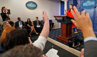 Reporters raise their hands to ask a question of Deputy White House press secretary Sarah Huckabee Sanders during an off-camera press briefing at the White House in Washington, Tuesday, July 11, 2017. (AP Photo/Alex Brandon)