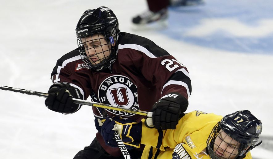 Union right wing Wayne Simpson (21) grapples with Quinnipiac center Jeremy Langlois (17) during the first period of their East Regional final in the NCAA college hockey tournament, Sunday, March 31, 2013, in Providence, R.I. (AP Photo/Steven Senne) **FILE**