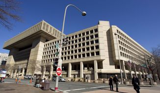 In this Feb. 3, 2012, file photo, the Federal Bureau of Investigation (FBI) headquarters in Washington. (AP Photo/Manuel Balce Ceneta, File) **FILE**