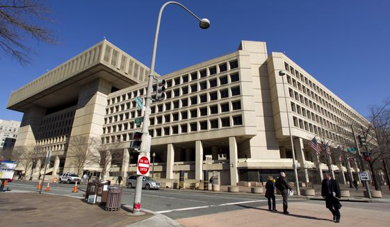 In this Feb. 3, 2012, file photo, the Federal Bureau of Investigation (FBI) headquarters in Washington. The government is scrapping a decade-long plan to shutter the FBI's deteriorating downtown Washington headquarters and look for a new building in Maryland or Virginia. (AP Photo/Manuel Balce Ceneta, File)