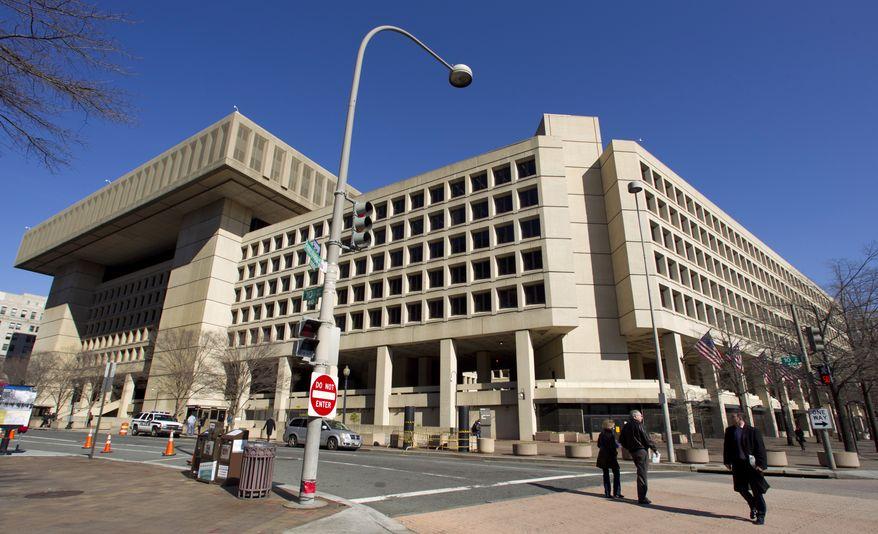 In this Feb. 3, 2012, file photo, the Federal Bureau of Investigation (FBI) headquarters in Washington. (AP Photo/Manuel Balce Ceneta, File) **FILE**