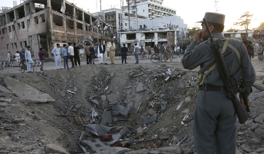 Security forces stand next to a crater created by a massive explosion that killed over 150, according to the Afghan president, in front of the German Embassy in Kabul, Afghanistan, on May 31, 2017. (Associated Press) **FILE**