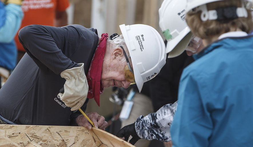 Former President Jimmy Carter helps build homes for Habitat for Humanity in Edmonton Alberta, Tuesday July 11, 2017. (Jason Franson/The Canadian Press via AP)