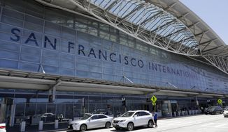 Vehicles wait outside the international terminal at San Francisco International Airport Tuesday, July 11, 2017, in San Francisco. (AP Photo/Marcio Jose Sanchez) ** FILE **