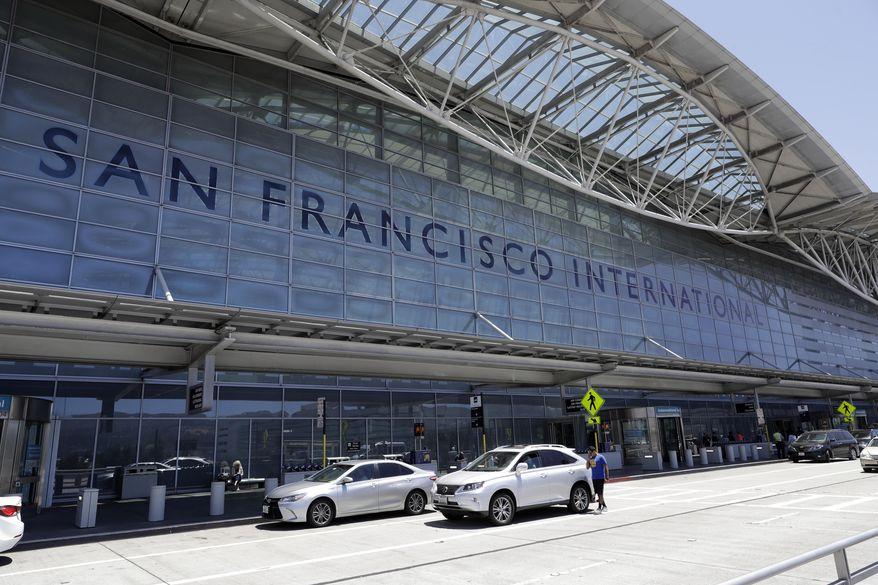 Vehicles wait outside the international terminal at San Francisco International Airport Tuesday, July 11, 2017, in San Francisco. (AP Photo/Marcio Jose Sanchez) ** FILE **