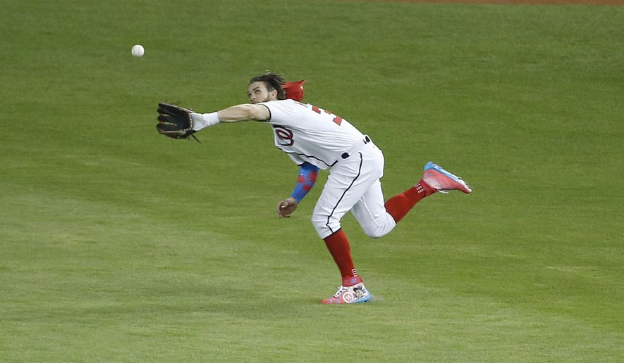 National League's Washington Nationals outfielder Bryce Harper (34) catches a hit by American League's Kansas City Royals Salvador Perez (13), during the second inning at the MLB baseball All-Star Game, Tuesday, July 11, 2017, in Miami. (AP Photo/Wilfredo Lee)