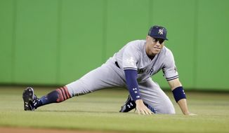 American League's New York Yankees outfielder Aaron Judge (99) stretches before the start of the MLB baseball All-Star Game, Tuesday, July 11, 2017, in Miami. (AP Photo/Lynne Sladky)