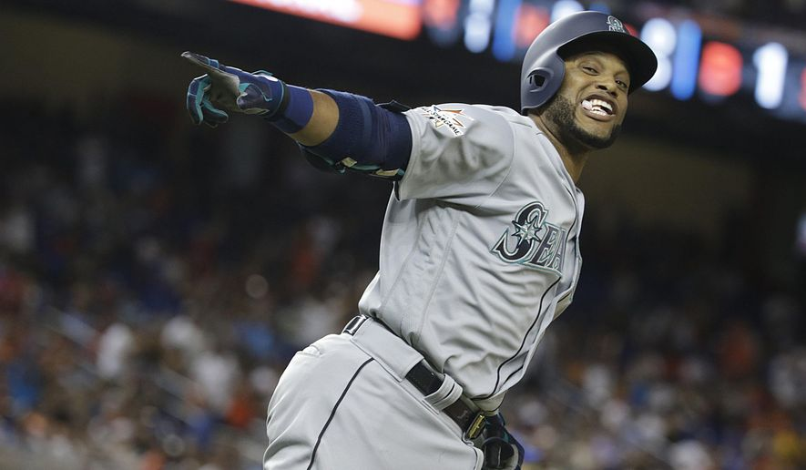American League's Seattle Mariners Robinson Cano (22), rounds the bases after hitting a homerun in the tenth inning, during the MLB baseball All-Star Game, Tuesday, July 11, 2017, in Miami. (AP Photo/Lynne Sladky)