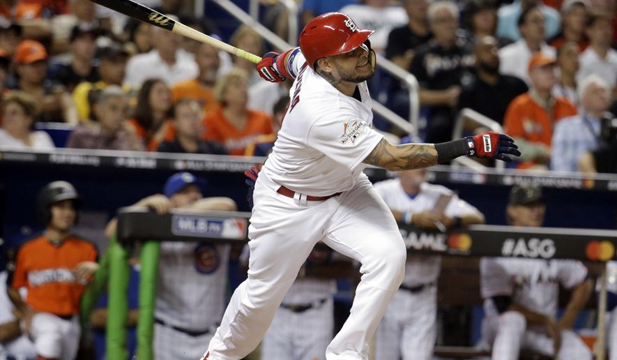National League's St. Louis Cardinals catcher Yadier Molina (4), hits a homerun in the sixth inning, during the MLB baseball All-Star Game, Tuesday, July 11, 2017, in Miami. (AP Photo/Lynne Sladky)