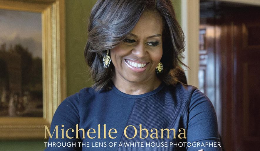 "This cover image released by Ten Speed Press shows, ""Chasing Light: Michelle Obama Through the Lens of a White House Photographer,"" by Amanda Lucidon. Ten Speed Press told The Associated Press on Tuesday, July 11, 2017, that the collection of White House pictures of Michelle Obama is coming out Oct. 17. (Amanda Lucidon/Ten Speed Press via AP)"