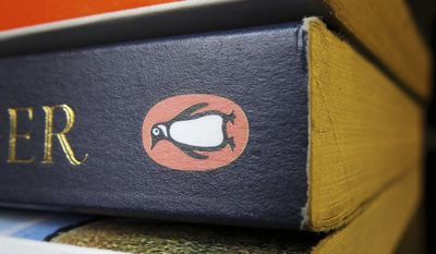 FILE - This Oct. 29, 2012 file photo shows three Penguin published books. British education publishing company Pearson says it will sell 22 percent of its shares in New York-based Penguin Random House to its German co-owner, Bertelsmann.  (Tim Ireland/PA via AP, File)
