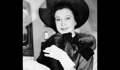 """FILE - This May 1958 file photo shows stage and screen actress Vivien Leigh. Vivien Leigh's copy of the """"Gone With the Wind"""" script is going up for auction on Sept. 26, 2017 alongside dozens of items from the late star's personal collection. (AP Photo, File)"""
