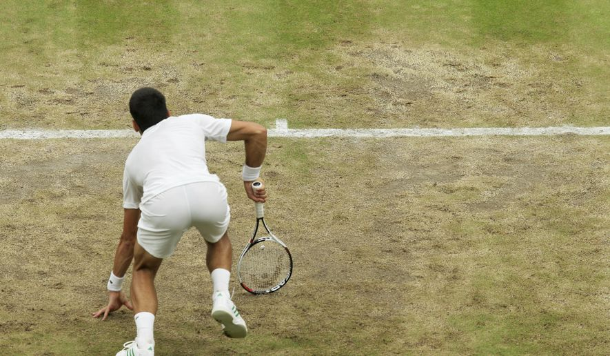 Serbia's Novak Djokovic slips on the baseline as he plays against Adrian Mannarino of France during their Men's Singles Match on day eight at the Wimbledon Tennis Championships in London Tuesday, July 11, 2017. (AP Photo/Tim Ireland)