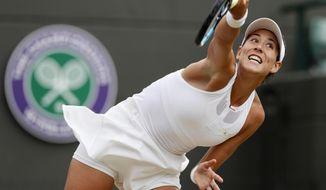 Spain's Garbine Muguruza returns to Russia's Svetlana Kuznetsova during their Women's Quarterfinal Singles Match on day eight at the Wimbledon Tennis Championships in London Tuesday, July 11, 2017. (AP Photo/Kirsty Wigglesworth)