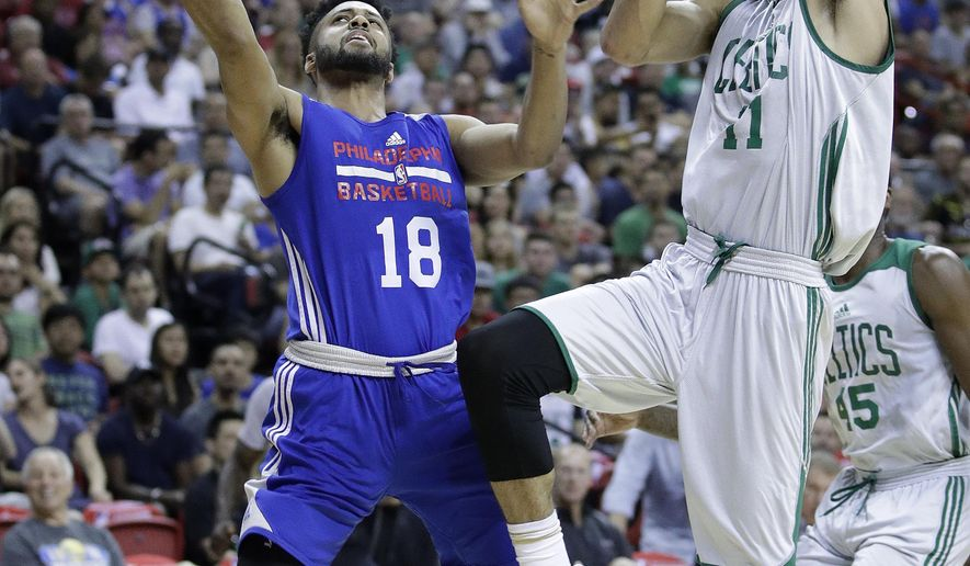 Philadelphia 76ers' Melo Trimble shoots around Boston Celtics' Jayson Tatum during the first half of an NBA summer league basketball game, Tuesday, July 11, 2017, in Las Vegas. (AP Photo/John Locher)