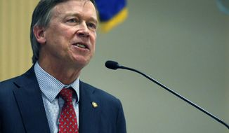 FILE - In this Jan. 12, 2017 file photo, Colorado Gov. John Hickenlooper delivers his annual State of the State in the state legislature in Denver. Hickenlooper announced Tuesday, July 11, 2017, that Colorado has joined a dozen others in endorsing the Paris global accord on climate change even though President Donald Trump is withdrawing the nation from the agreement. Hickenlooper said the state will also set goals for reducing greenhouse gas emissions from electricity generation, adding charging stations for electric cars and making buildings more energy-efficient. (AP Photo/Brennan Linsley, File)